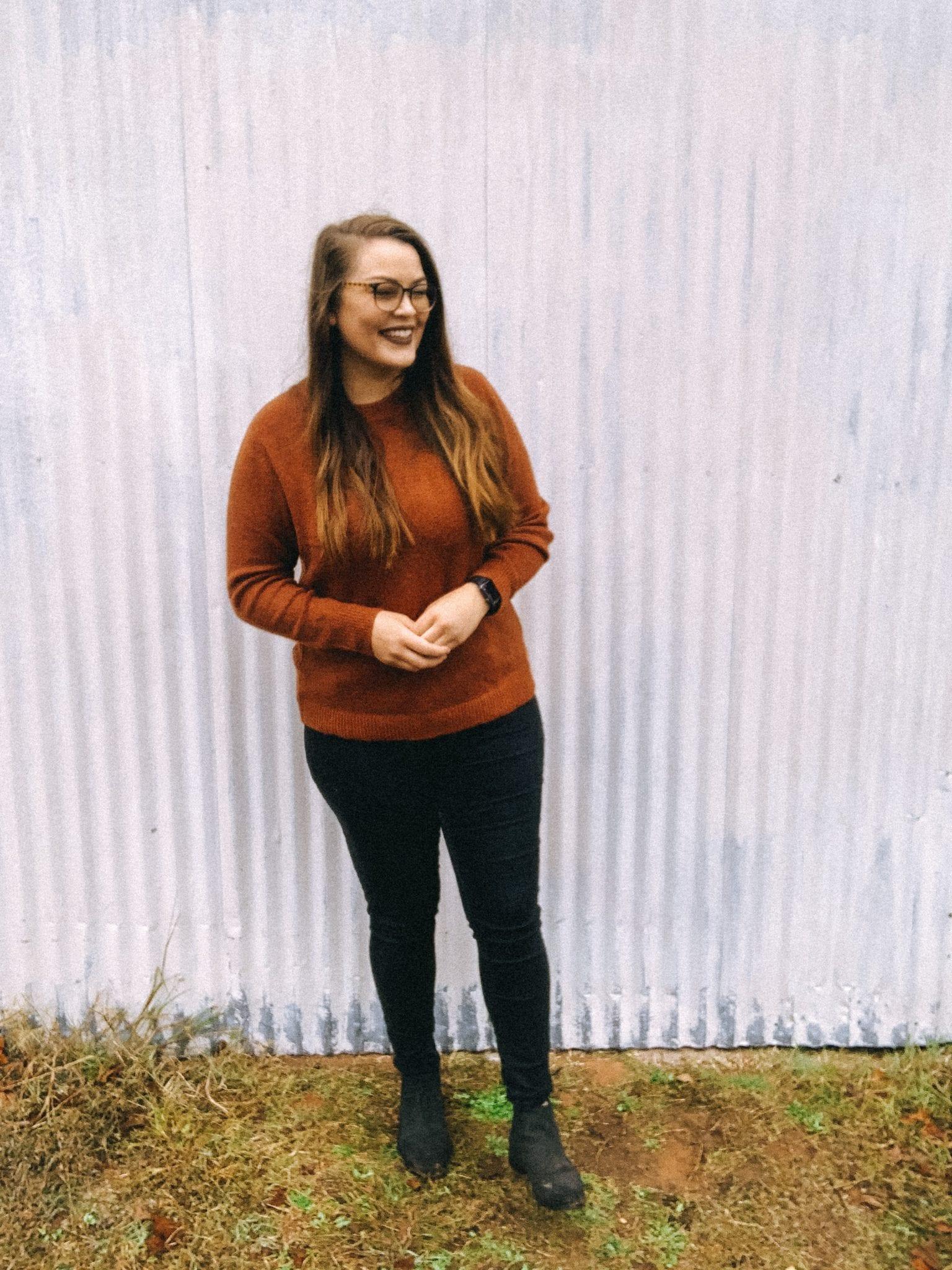 Braidyn standing in front of a barn door, smiling.